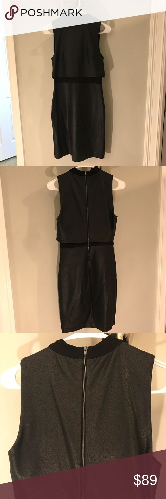 French Connection Dress Black French Connection dress. This dress is mad out of a fabric with a slight shine to it which gives it a faux leather look. Very form fitted and classy, huts at right about the knee and I am 5'5. Fits a true 4. All offers will be considered! French Connection Dresses Mini