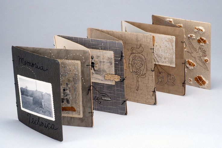 Memoria Technica by Lisa Kokin. Cardboard photo frames, thread, found photos, mixed media collage,  8 x 50 x 8 inches, 2002