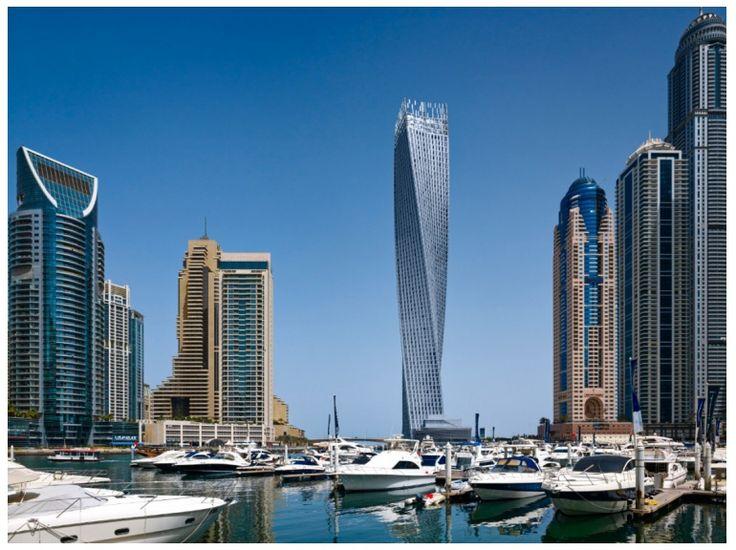 Cayan Tower, à Dubai. Situé dans la Marina du Dubai, Cayan Tower est le plus haut bâtiment tourné sur 90°, formant ainsi une hélice. L'intérêt de cette architecture tortueuse est de diminuer la prise au vent. Elle est directement inspirée de la Turning torso de Malmö, en Suède.Le bâtiment, qui a nécessité 7 ans de travaux, a été conçu par l'agence américaine Skidmore, Owings and Merrill (SOM). Il culmine à 307 mètres et abrite essentiellement des logements et des magasins.