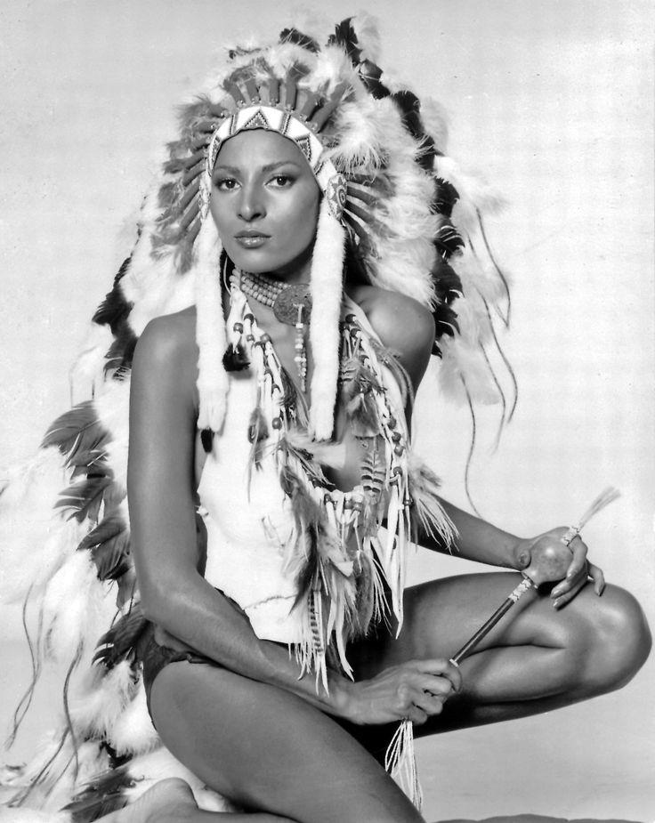 Actress Pam Grier wearing Native American headdress