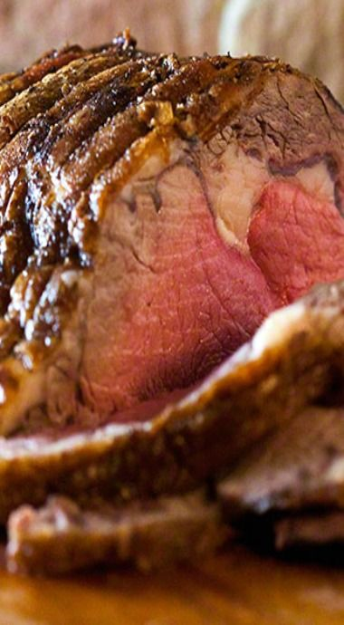 Standing prime rib beef roast, cooked to perfection, this roast is rich, juicy, and tender—a feast for the eyes and the belly... perfect for Christmas and the holidays!