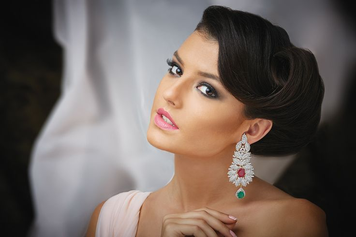 Long hanging earrings in Zircon stones with a green drop at Kushal's Fashion Jewellery