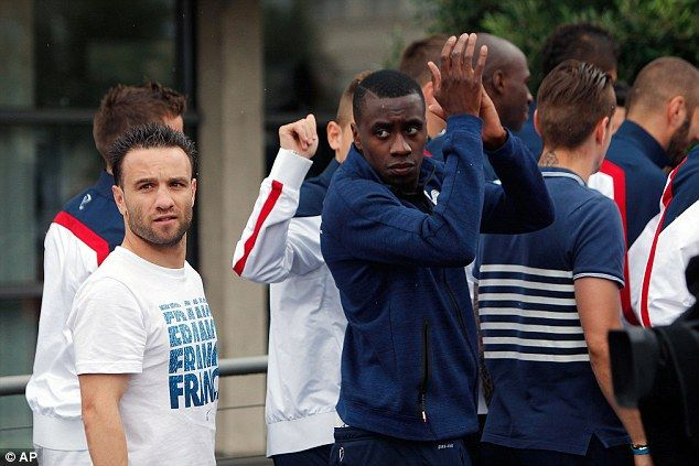 Fans' favourite: Blaise Matuidi (right) applauds the French supporters as Mathieu Valbuena...