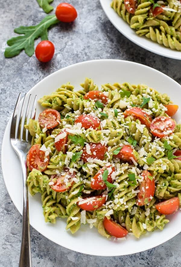 A recipe for creamy avocado pesto that tastes decedent but is loaded with super foods. This nut-free pesto is great on pasta, sandwiches and Mexican dishes.