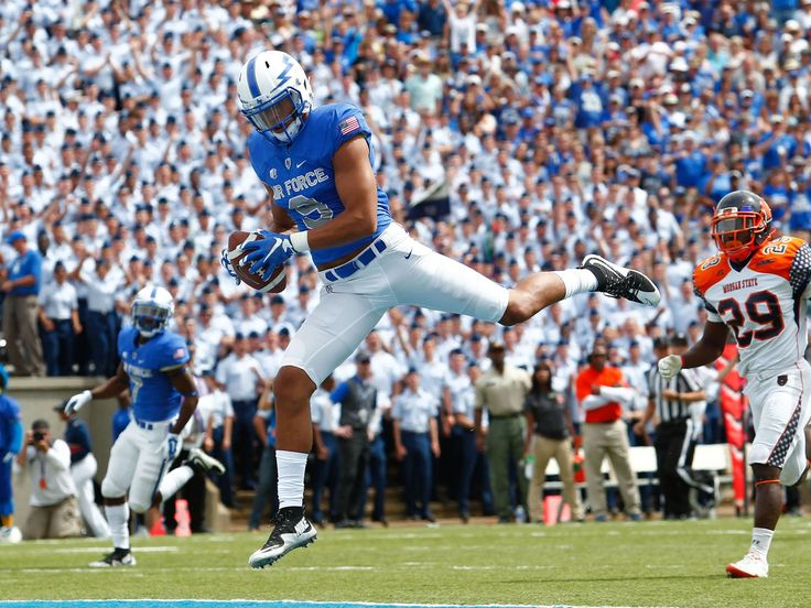 Air Force receiver Jalen Robinette (9) makes a leaping catch for a touchdown during the first quarter against Morgan State in Colorado Springs. Robinette's score helped the Falcons rolls to a 63-7 win.  Isaiah J. Downing, USA TODAY Sports
