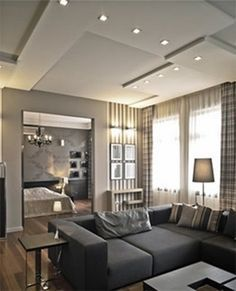 Contemporary Dropped Ceiling Treatment - This home from Budapest uses a contemporary ceiling treatment by varying heights & geometric patterns. Notice the square recessed pot lights.