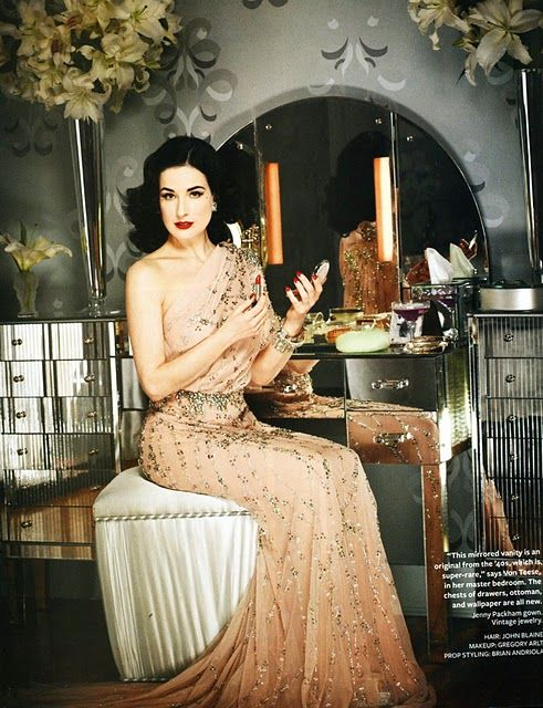 "Dita Von Teese, known as ""The Queen of Burlesque,"" lives in glam retro style at home in L.A., and the February issue of InStyle magazine has some seriously gorgeous photos of it. The house was built in the 1940s, her favorite era, and was decorated by designer Stacia Dunnam."