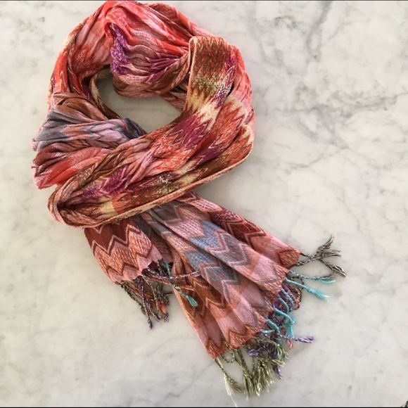 """Pink + Red Zig Zag Scarf This stretchy scarf bought at Anthropologie is super soft, stretchy and snuggly. Made of 100% viscose. Colors are warm with reds, pinks, purples, cream and a hint of green and blue. Great condition! Length 74"""" and width 10"""". Anthropologie Accessories Scarves & Wraps"""