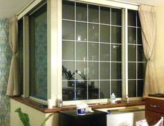 Faux window panes that look like French panes. This could be a nice diy update for some of our windows, especially the bay window! I wonder how it would look with only the bottom half of the double hung windows done?