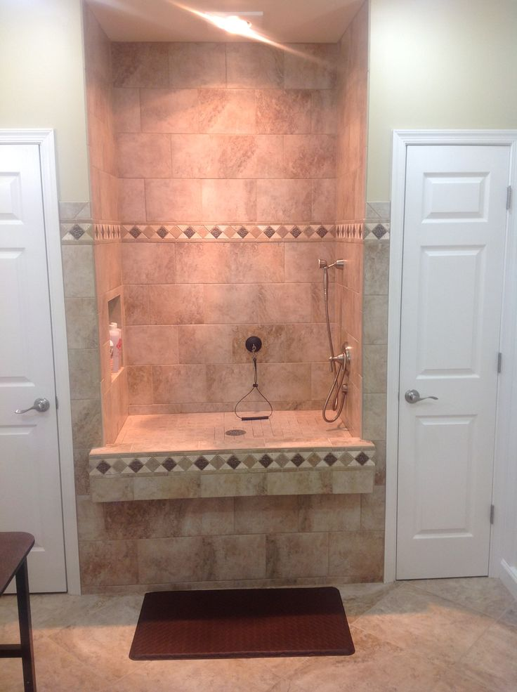 Raised dog shower with heat lamp above and nuheat tile ...
