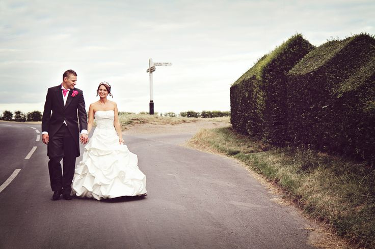 Bride and Groom taking a stroll at the front of the barns.