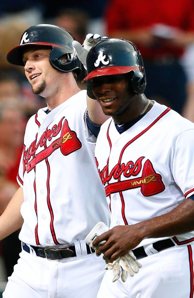 ATLANTA, GA - AUGUST 13: Chris Johnson #23 of the Atlanta Braves celebrates his two-run homer against the Philadelphia Phillies in the third inning with Justin Upton #8 at Turner Field on August 13, 2013 in Atlanta, Georgia. (Photo by Kevin C. Cox/Getty Images)