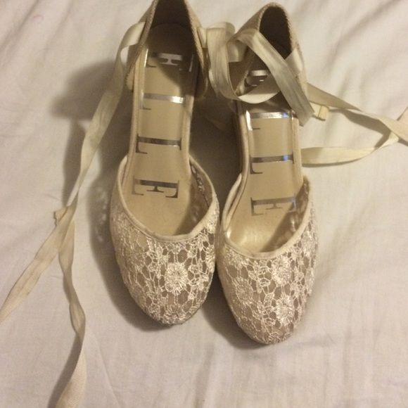 Elle shoes only wear once.Willing to negotiate!!!! Lace fronts wedges on the side very nice wore them to graduation and they don't go with any of my outfits anymore so I'm selling them hope you like them string so you can tie it around your leg Elle Shoes Wedges