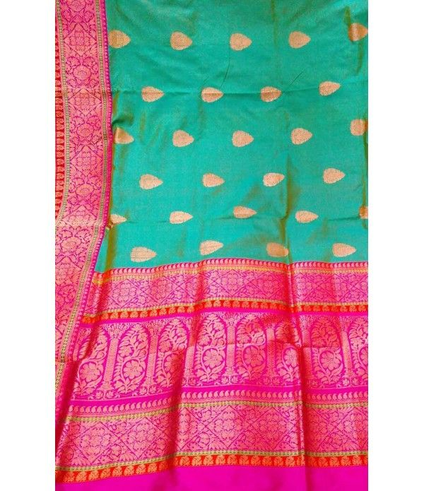 Green Pure Handloom Banarasi Katan Silk Saree--- Banarasi silk is an unmatched example of excellent artistry. Mughals brought this fine craftsmanship in India. Mughals also tried their best to glorify the art of weaving and designing. During the course of that act, they inspired few craftsmen to work in intricate art of weaving.-- For details click here -- http://luxurionworld.com/banarasi-Sarees-varanasi-pure-silk/LWBSNJ152_Green_Pure_Handloom_Banarasi_Katan_Silk_Saree.html