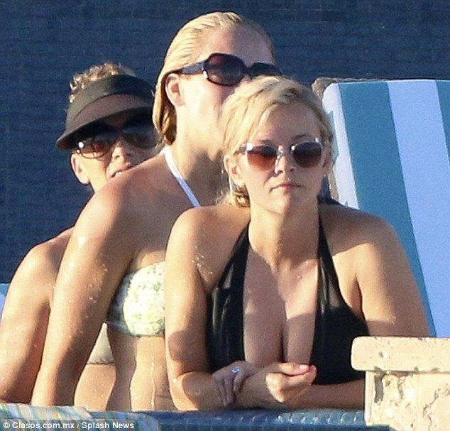 Cooling off: The 39-year-old. who wore her hair in a ponytail, took a dip in the water aft...