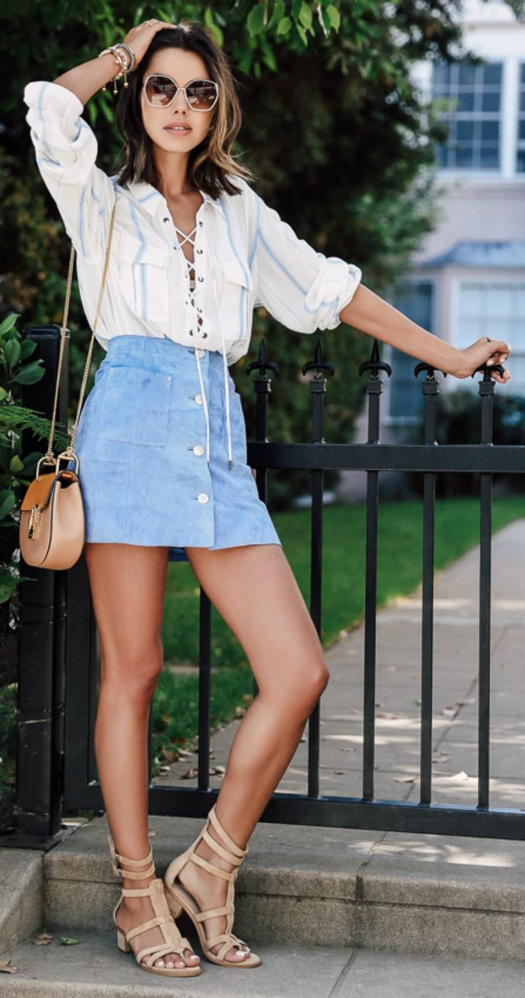 Lace up + blouse + wear + the trend + Annabelle Fleur + super cute + blouse + matched + pastel blue + button front skirt + perfect + spring Blouse: L'Academie X Revolve, Skirt: Asos, Bag: Chloe.