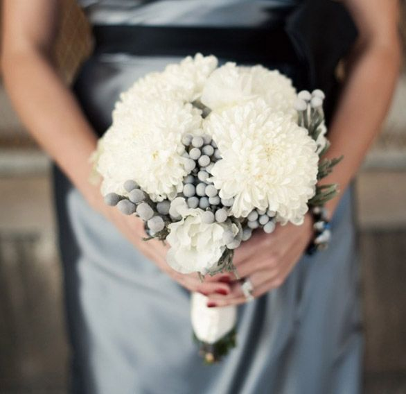Christmas chrysanthemum bouquet against stunning silver dress with midnight blue sash