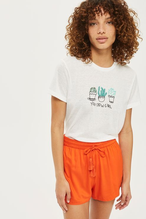 Bring colour the beach with these vibrant orange shorts. Pair with a triangle bikini top or slogan t-shirt for an easy summer look.