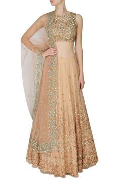 This set features a peach lehenga in net base with gold and peach thread and sequins floral work around the ghera. It has a can-can underlayer. It comes along with peach sleeveless blouse with golden