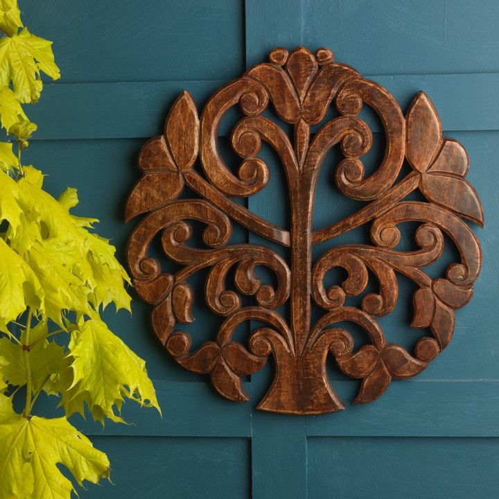 This hand carved wooden Tree of Life wall panel has been hand carved by expert artisans in India. Whittled from the finest mango wood and stained a rich dark brown, its a beautiful, unique piece for any home.