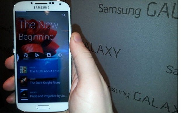 The new Samsung Galaxy S4 features a touchscreen that detects when a user's finger is hovering over the screen to display additional preview information, as well as technology that automatically pauses videos if a user looks away from the screen. It also includes new features that monitor a user's well-being, and accessories will include a scales and heart-rate monitor from Samsung as well as a blood pressure and blood sugar monitor from other companies.