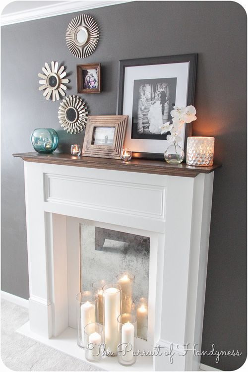 Faux Fireplace. Love the overall look of this mantel!
