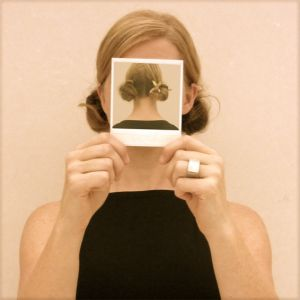 Hidden identity, this is really interesting that she is hiding her face with an image of the back of her head.