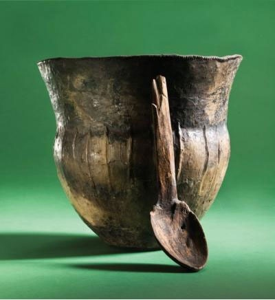 A 6,000 year old cooking pot and wooden spoon recovered from the Åmose Bog in Zealand, Denmark. These artefacts are thought to have been votive offerings by the earliest farming communities who lived in this area. Chemical analysis of charred food residues preserved on the inside of a number of these vessels, show they were used for processing freshwater fish, which supplemented their fledgling agricultural economy.
