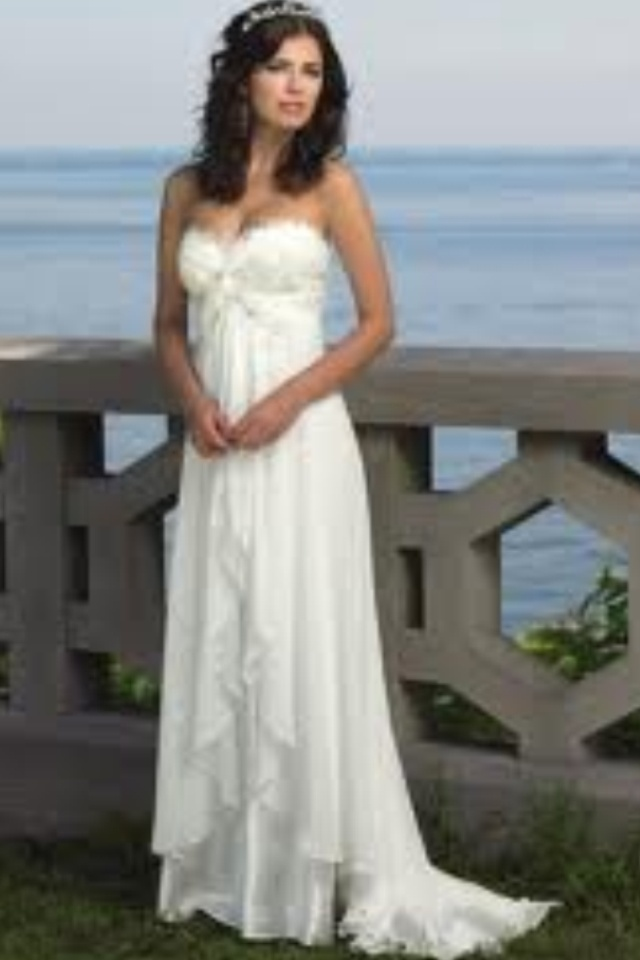 Beautiful white flowy wedding dress with design on the for Flowy white wedding dress