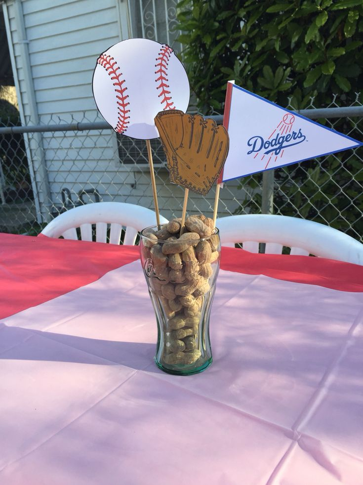Quick and Easy baseball theme party centerpiece! Coke cola cup from Dollar Tree filled with peanuts and baseball, glove and Dodgers flag; all printed from computer on cardstock!