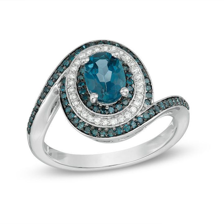 Zales Oval London Blue Topaz and 1/2 CT. T.W. Enhanced Blue and White Diamond Swirl Frame Ring in 10K White Gold