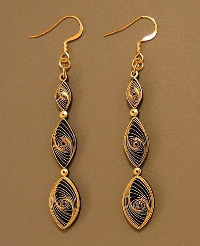 Vortex coil. http://en.paperblog.com/quilling-101-gilded-earrings-729945/