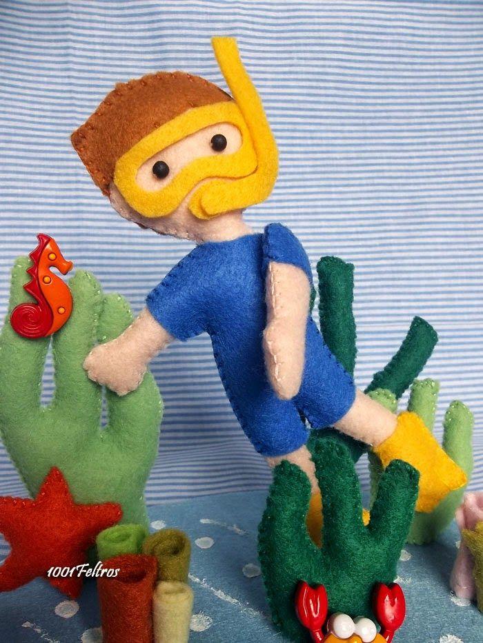 Continuando com a decoração da festinha do pequeno Lucca. Esse menino mergulhador, tem uns 15 cm de altura: topo de bolo.       O polvo ...