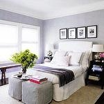 bedrooms - gray violet purple white upholstered headboard bed purple velvet throw blanket bedding silver urn lamps ticking gray slip-covered ottomans Asian wood bench black white photo gallery glossy black step tables nightstands sisal rug purple walls