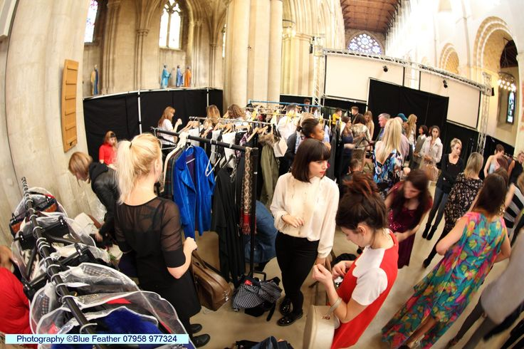 The busy dressing room full of beautiful clothes ready to be shown off on the catwalk! #SAFW14
