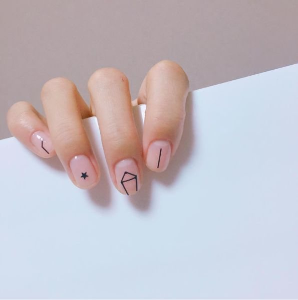 Constellation Manicures Are The Nail Art You Actually Want #refinery29  http://www.refinery29.com/2016/12/131604/constellation-manicures-instagram#slide-2  We love the abstract design and simplicity of this take on the trend....