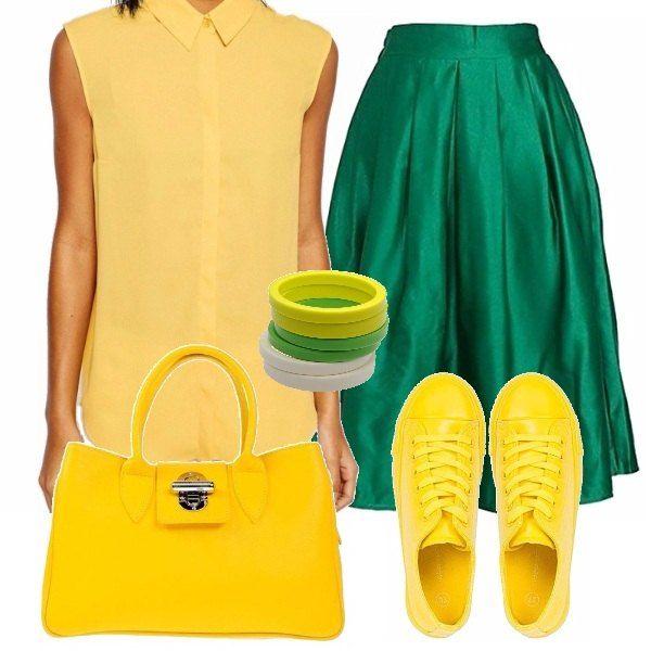 """Un look un po' """"Carioca"""" ma che funziona, per un look di giorno, sportivo ma chic. Blusa senza maniche con colletto polo color giallo, gonna svasata verde smeraldo, scarpe da tennis e borsa in giallo canarino, accessori in tono."""