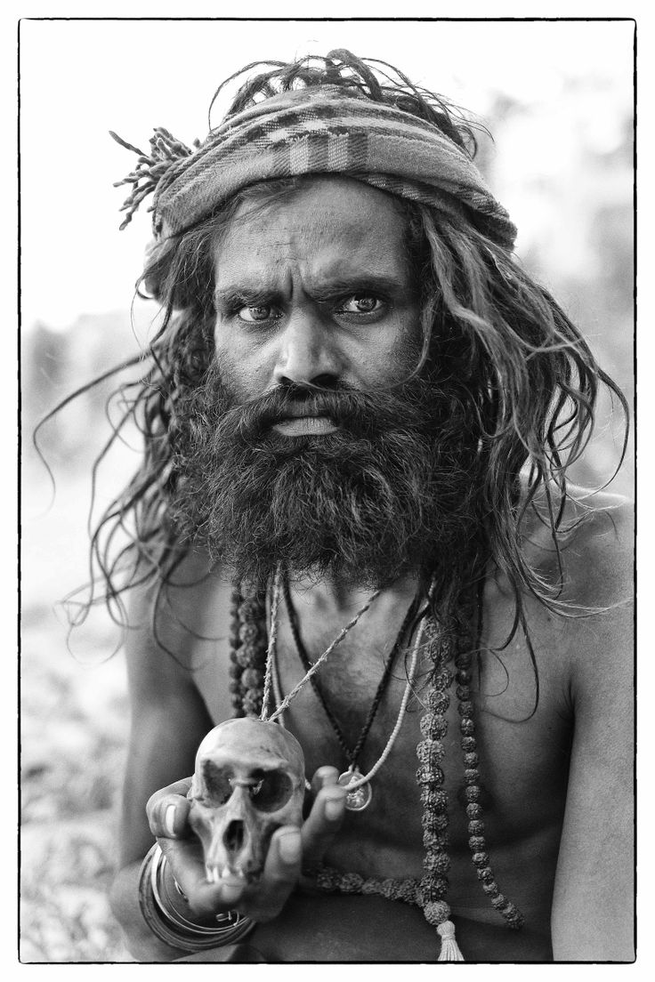 An Aghori sits by the Ganges in Varanasi.: