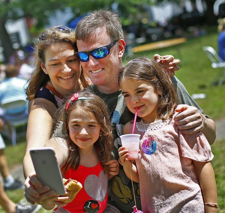 Happy Father's Day, Stuart Hall of Hingham with daughters Olivia-5 and Ariana-6 at the South Shore Arts Festival get a selfie snapped by wife and mom Maria on Sunday June 18, 2017 Greg Derr/The Patriot Ledger