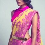 Yellow and pink net saree with pink sleev less collar blouse by Neeta Lulla