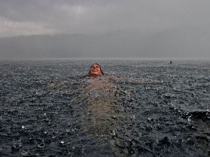 a woman swimming in a lake in Chile during a rainstorm, Rainstorm, Chile PHOTOGRAPH BY CAMILA MASSU