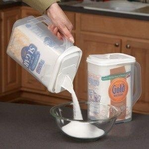 Put pouring items (like sugar and flour) into pouring containers like this one found at Ikea.