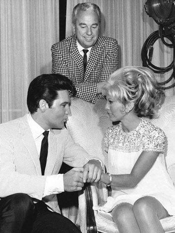 Elvis and actress Nancy Sinatra between scene in summer ...