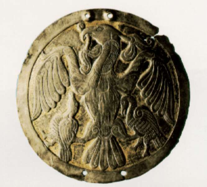 A badge depicting a turul. Gold-plated silver from Hungary