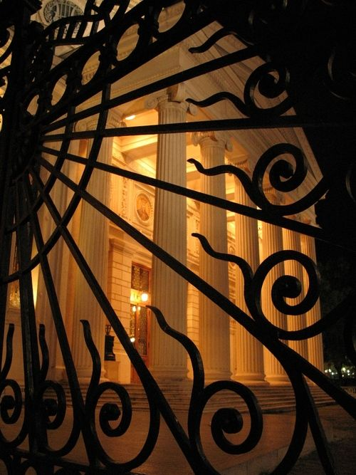Looking through the iron gate at the Romanian Athenaeum, in Bucharest, Romania.  Love the iron work!