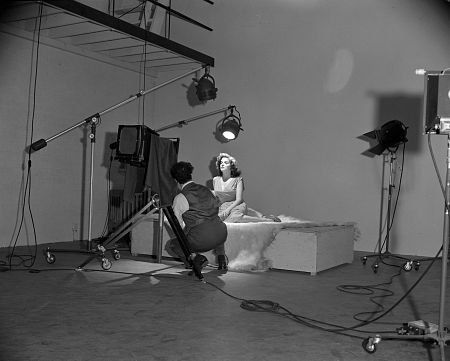 George Hurrell - most well sought after and highest paid Hollywood photographer  - in his photography studio, posing Jane Russell