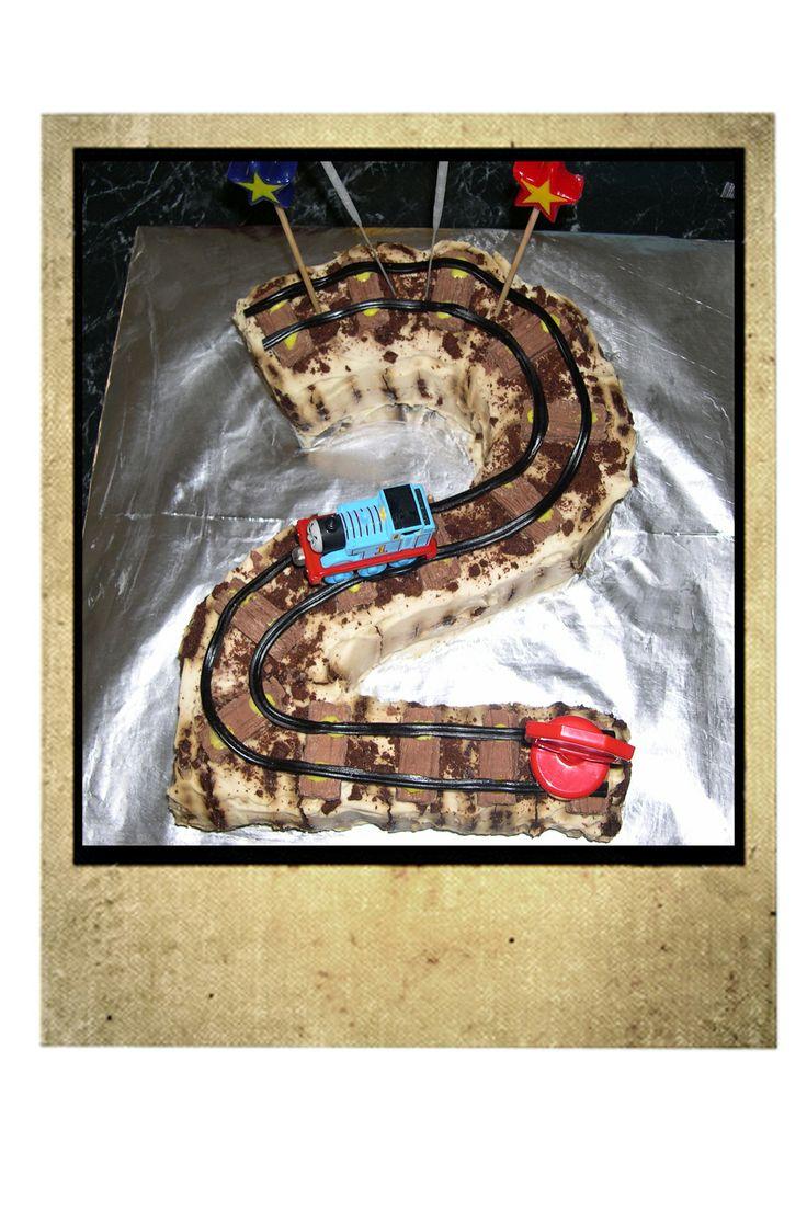 G's 2nd Birthday Train Track Cake.  Chocolate Ripple, with cream, liquorice, and flake. + Thomas train and stop sign.