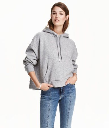 Gray melange. Sweatshirt with a lined drawstring hood. Long sleeves, dropped shoulders, kangaroo pocket, and ribbing at cuffs and hem. Soft, brushed inside.