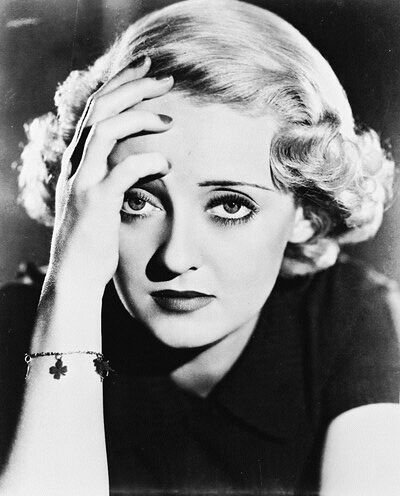 """Bette Davis. """" I'd love to kiss you, but I just washed my hair.""""--from Cabin In The Sky."""