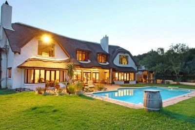 Magnificent views, variety of granite and tiled floors, rose wood kitchen. Fold away doors to the pool. Established trees in magnificent setting of Upper Constantia